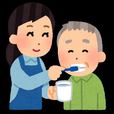 歯磨きを手伝っている人